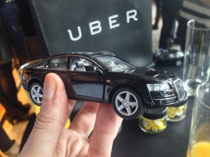 Black car and Uber logo