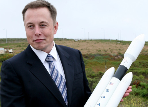 Elon Musk holding his SpaceX rocket